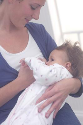 Me feeding Esmé in my Rooti Tooti vest and wrap